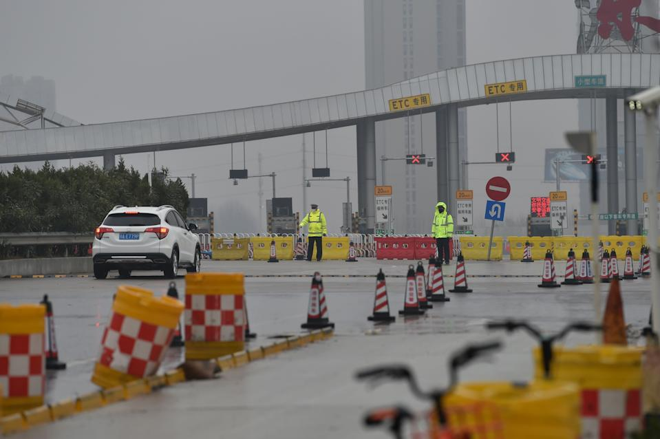 A general view shows one of the roads blocked by the police to restrict people leaving Wuhan in China's central Hubei province on January 25, 2020, during a deadly virus outbreak which began in the city. - The Chinese army deployed medical specialists on January 25 to the epicentre of a spiralling viral outbreak that has killed 41 people and spread around the world, as millions spent their normally festive Lunar New Year holiday under lockdown. (Photo by Hector RETAMAL / AFP) (Photo by HECTOR RETAMAL/AFP via Getty Images)