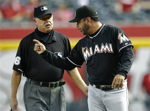 Miami Marlins manager Ozzie Guillen, right, argues with umpire Jim Joyce during the third inning of a baseball game against the Arizona Diamondbacks, Wednesday, Aug. 22, 2012, in Phoenix. (AP Photo/Matt York)
