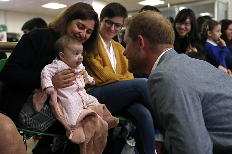 Prince Harry, Duke of Sussex chats with 3 months old baby Naz and mother Maria Ahmad (Getty Images)