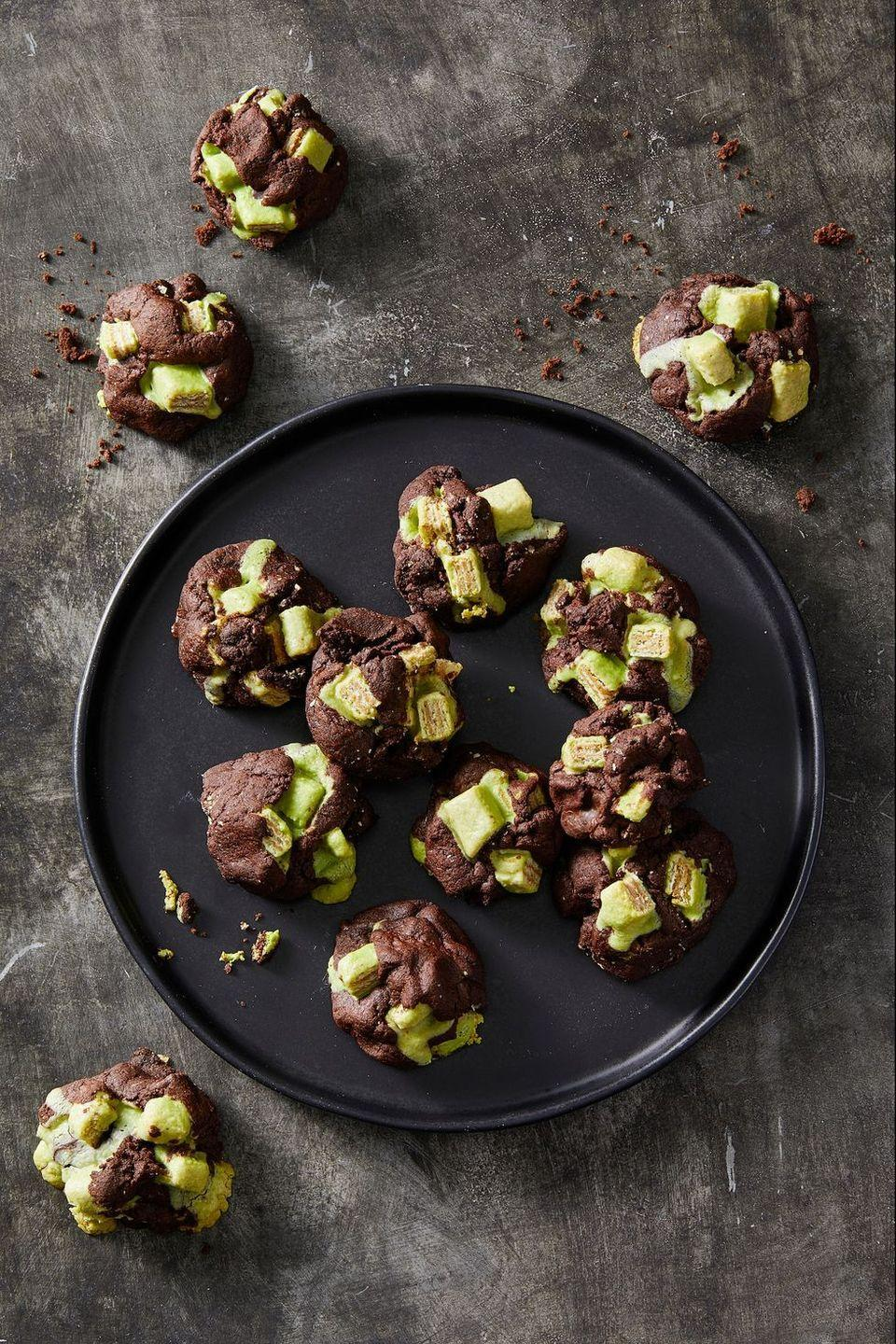 """<p>Green candy pieces add a ghoulish touch to a devilish dark chocolate cookie.</p><p><em><a href=""""https://www.goodhousekeeping.com/food-recipes/a28541666/dark-chocolate-candy-cookies-recipe/"""" rel=""""nofollow noopener"""" target=""""_blank"""" data-ylk=""""slk:Get the recipe for Dark Chocolate Candy Cookies »"""" class=""""link rapid-noclick-resp"""">Get the recipe for Dark Chocolate Candy Cookies »</a></em></p>"""