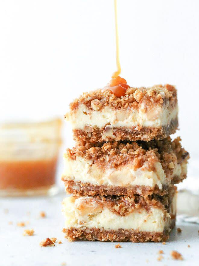 """<a href=""""https://www.completelydelicious.com/caramel-apple-cheesecake-bars/"""" rel=""""nofollow noopener"""" target=""""_blank"""" data-ylk=""""slk:Get the Caramel Apple Cheesecake Bars recipe from Completely Delicious"""" class=""""link rapid-noclick-resp""""><strong>Get the Caramel Apple Cheesecake Bars recipe from Completely Delicious</strong></a>"""