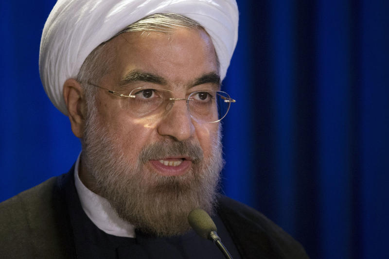 FILE - In this Sept. 26, 2013 file photo, Iranian President Hassan Rouhani speaks during a address and discussion hosted by the Asia Society and the Council on Foreign Relations at the Hilton Hotel in midtown Manhattan, in New York. Always the subject of intense scrutiny, Iran will now be under the microscope as Washington looks for signals that its new president is both serious and sufficiently powerful to pursue detente with Washington and craft an exit from painful sanctions over its nuclear program. (AP Photo/John Minchillo, File)