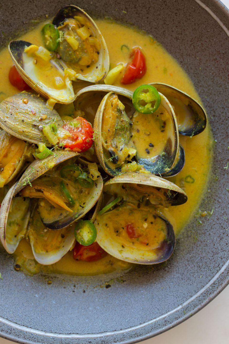 "<p>Nothing says summer like this sweet and spicy seafood dinner. </p><p>Get the recipe from <a href=""http://www.spoonforkbacon.com/2013/01/coconut-green-curry-steamed-clams/"" rel=""nofollow noopener"" target=""_blank"" data-ylk=""slk:Spoon Fork Bacon"" class=""link rapid-noclick-resp"">Spoon Fork Bacon</a>.</p>"