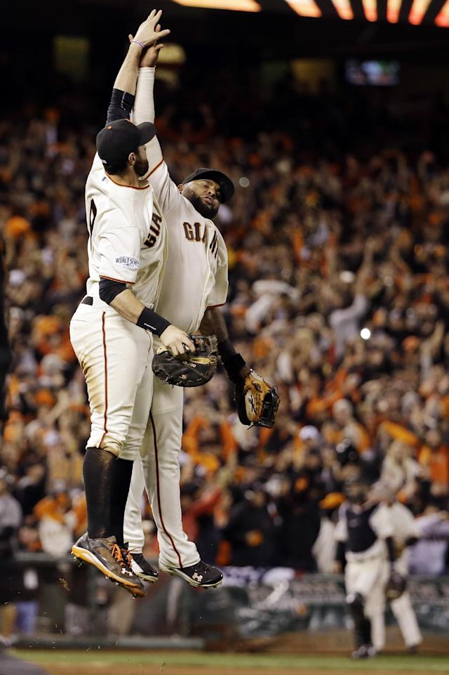 San Francisco Giants' Brandon Belt and Pablo Sandoval celebrate after Game 5 of baseball's World Series against the Kansas City Royals Sunday, Oct. 26, 2014, in San Francisco. The Giants won 5-0 to take a 3-2 lead in the series. (AP Photo/David J. Phillip)