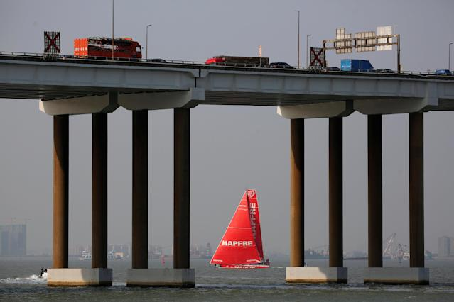 Sailing - Volvo Ocean Race - In-Port Race - Guangzhou, China - February 3, 2018. MAPFRE sails behind Humen Bridge after winning. REUTERS/Bobby Yip TPX IMAGES OF THE DAY