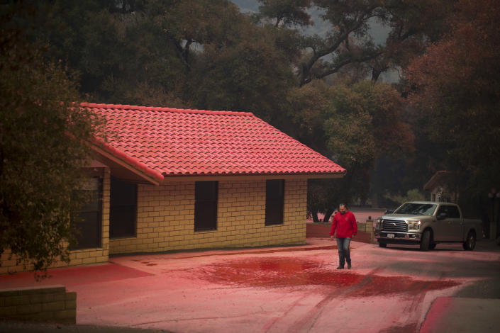<p>Red fire retardant dropped from firefighting aircraft covers the grounds at the Salvation Army camps in Malibu Creek State Park during the Woolsey Fire on Nov. 10, 2018 near Malibu, Calif. (Photo: David McNew/Getty Images) </p>