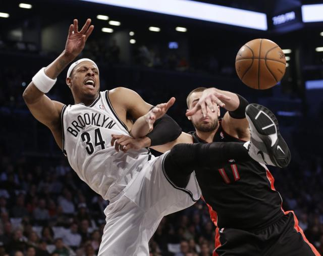 Brooklyn Nets' Paul Pierce, left, and Toronto Raptors' Jonas Valanciunas, vie for control of the ball during the first half of Game 3 of an NBA basketball first-round playoff series Friday, April 25, 2014, in New York. (AP Photo/Frank Franklin II)