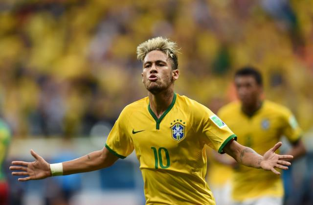 Brazil's forward Neymar celebrates after scoring a second goal during the match between Cameroon and Brazil at the Mane Garrincha National Stadium in Brasilia on June 23, 2014 (AFP Photo/Pedro Ugarte)