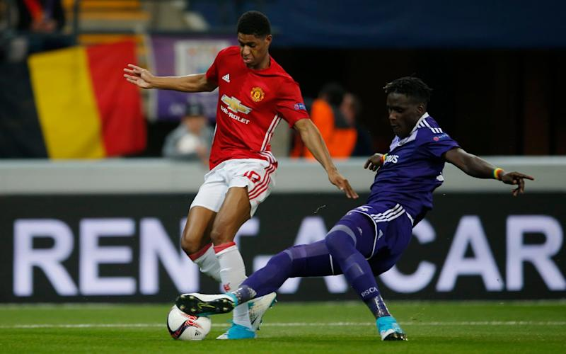 Anderlecht's Mbodji Kana makes a fine, vital tackle to stop Marcus Rashford - Credit: Action Images/Andrew Couldridge