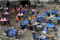 FILE - In this May 6, 2021 file photo, Maricopa County ballots cast in the 2020 general election are examined and recounted by contractors working for Florida-based company, Cyber Ninjas at Veterans Memorial Coliseum in Phoenix. Republican Senate President Karen Fann said, Monday, Aug. 23 that the delivery of the report on the 2020 vote count to Arizona state Senate Republicans was delayed, after the Donald Trump supporter hired to lead the effort and several others involved contracted COVID-19. Fann said she still expects to receive a portion of the report, Monday, but did not give a date for delivery of the full draft. (AP Photo/Matt York, Pool, File)