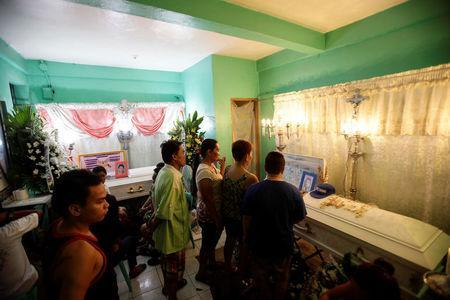 People attend the wake of Michael Siaron in Pasay, Metro Manila, Philippines July 28, 2016. REUTERS/Czar Dancel