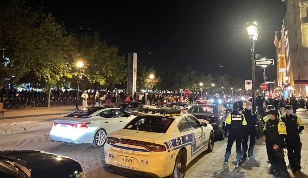 While there was a heavy police presence, no interventions were made to stop gatherings on Friday night.