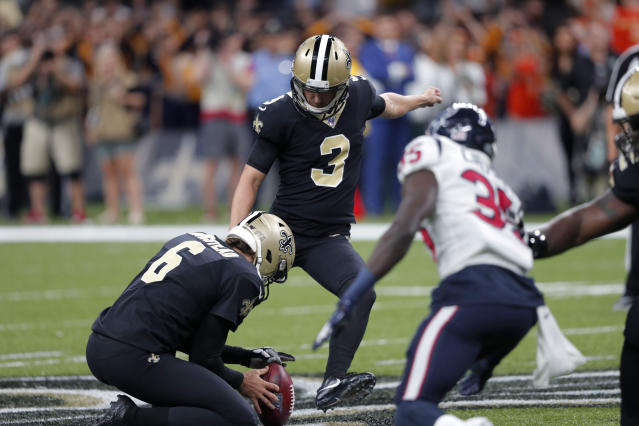 New Orleans Saints kicker Wil Lutz (3) kicks a 58 yard field goal as Thomas Morstead (6) holds, at the end of regulation, in the second half of an NFL football game against the Houston Texans in New Orleans, Monday, Sept. 9, 2019. The Saints won 30-28. (AP Photo/Bill Feig)