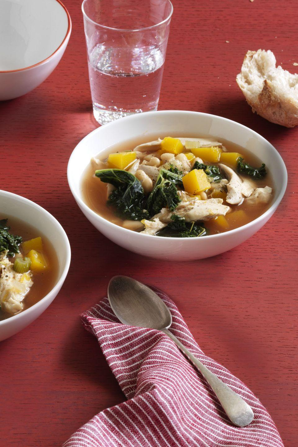 """<p>Substitute the chicken with leftover turkey for the ultimate day-after-Thanksgiving soup.</p><p><em><a href=""""https://www.goodhousekeeping.com/food-recipes/a15711/kale-white-bean-butternut-squash-soup-recipe-wdy0214/"""" rel=""""nofollow noopener"""" target=""""_blank"""" data-ylk=""""slk:Get the recipe for Kale, White Bean, and Butternut Squash Soup »"""" class=""""link rapid-noclick-resp"""">Get the recipe for Kale, White Bean, and Butternut Squash Soup »</a></em><strong><br></strong></p><p><strong>RELATED: </strong><a href=""""https://www.goodhousekeeping.com/holidays/thanksgiving-ideas/g1471/leftover-turkey-recipes/"""" rel=""""nofollow noopener"""" target=""""_blank"""" data-ylk=""""slk:24 Leftover Turkey Recipes You Can Make in 60 Minutes or Less"""" class=""""link rapid-noclick-resp"""">24 Leftover Turkey Recipes You Can Make in 60 Minutes or Less</a></p>"""