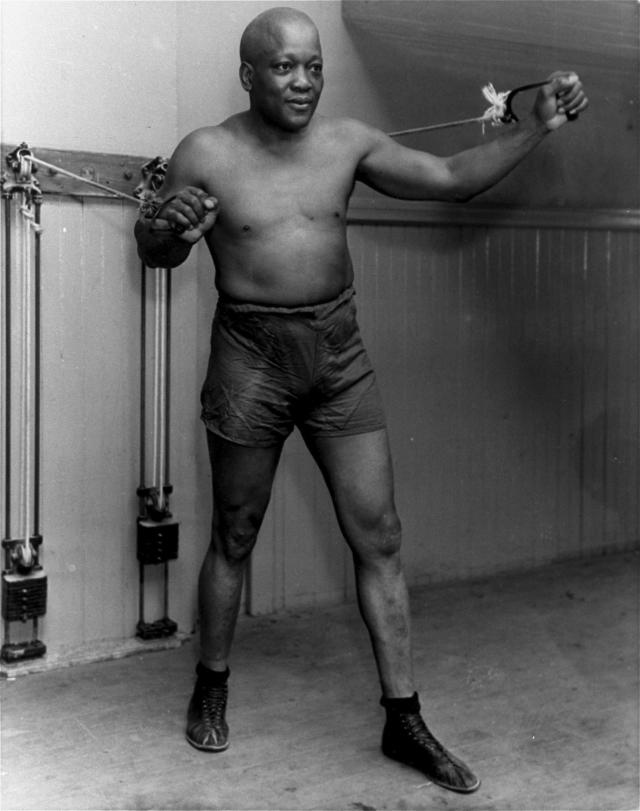 FILE - In this 1932 file photo, boxer Jack Johnson work out in New York City. President Donald Trump on Thursday, May 24, 2018, granted a rare posthumous pardon to boxing's first black heavyweight champion, clearing Jack Johnsons name more than 100 years after a racially-charged conviction. (AP Photo/File)