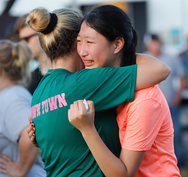 <p>Friends and family attend a vigil held at the First Bank in Santa Fe for the victims of a shooting incident at Santa Fe High School where a shooter killed at least 10 students on May 18, 2018 in Santa Fe, Texas. (Photo: Bob Levey/Getty Images) </p>