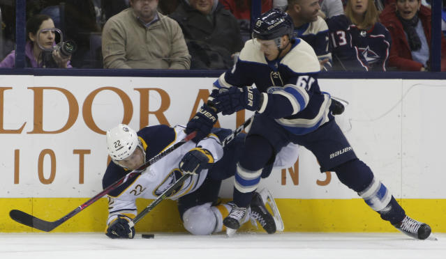Columbus Blue Jackets' Markus Nutivaara, right, of Finland, checks Buffalo Sabres' Johan Larsson, of Sweden, during the first period of an NHL hockey game Tuesday, Jan. 29, 2019, in Columbus, Ohio. (AP Photo/Jay LaPrete)