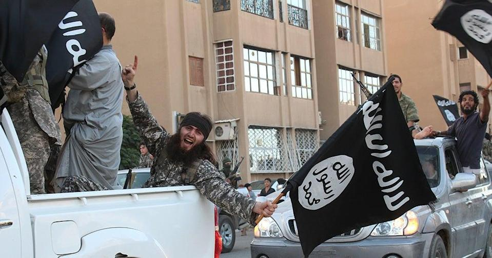 Isis parading in the northern Syrian city of Raqa in 2014 (WELAYAT RAQA/AFP via Getty Image)