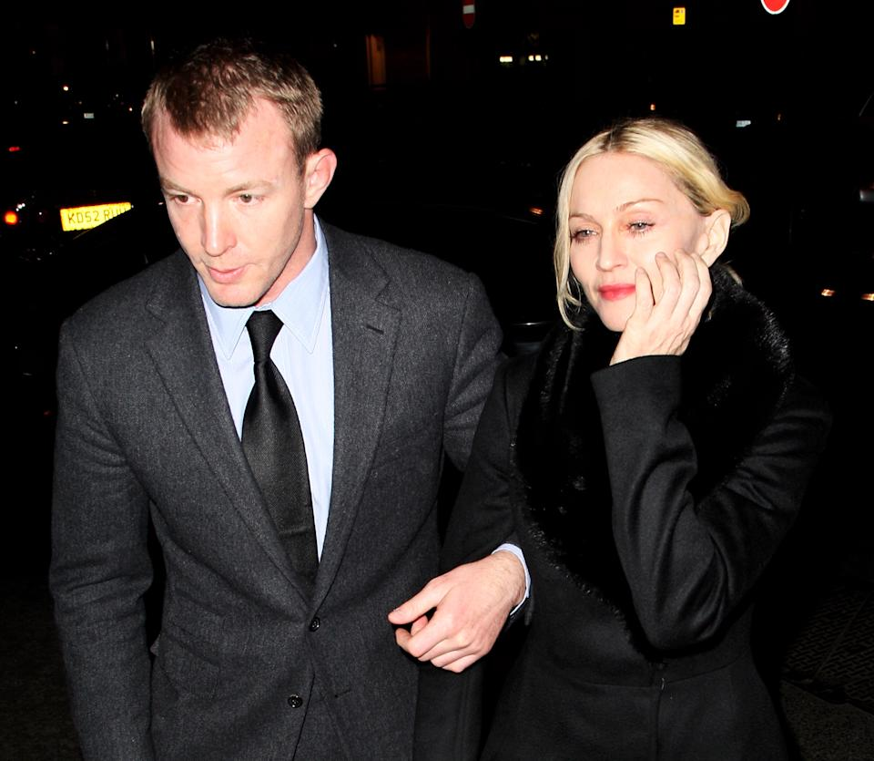 Madonna and Guy Ritchie arrive at Harry's, Mayfair on March 18, 2008 in London, England. (Photo by Dave Hogan/Getty Images)