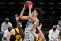 Northwestern guard Ty Berry drives to the basket against Iowa during the second half of an NCAA college basketball game in Evanston, Ill., Sunday, Jan. 17, 2021. (AP Photo/Nam Y. Huh)