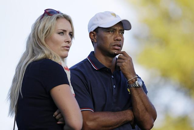 United States' Tiger Woods watches the 17th hole with his girlfriend Lindsey Vonn during the four-ball matches at the Presidents Cup golf tournament at Muirfield Village Golf Club Thursday, Oct. 3, 2013, in Dublin, Ohio. (AP Photo/Darron Cummings)