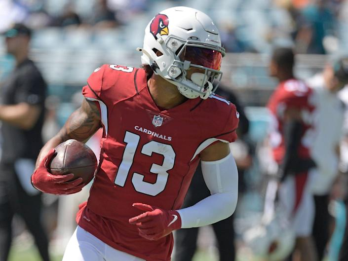Christian Kirk warms up for a game against the Jaguars.