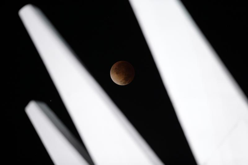 The moon is shown in eclipse in Brasilia