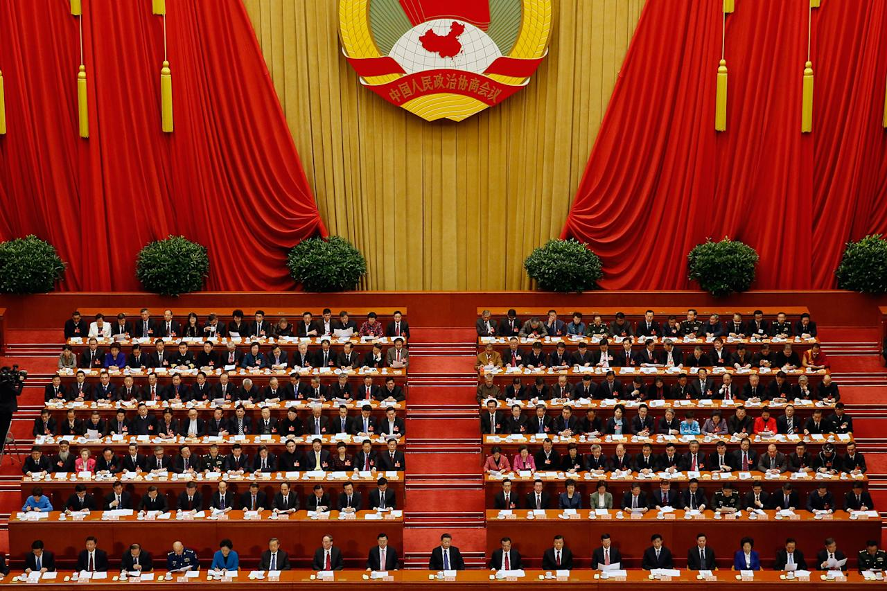 <p>Chinese President Xi Jinping, foreground center, Premier Li Keqiang, foreground center right, and delegates attend a closing session for the Chinese People's Political Consultative Conference (CPPCC) at the Great Hall of the People in Beijing, Monday, March 13, 2017. (AP Photo/Andy Wong) </p>