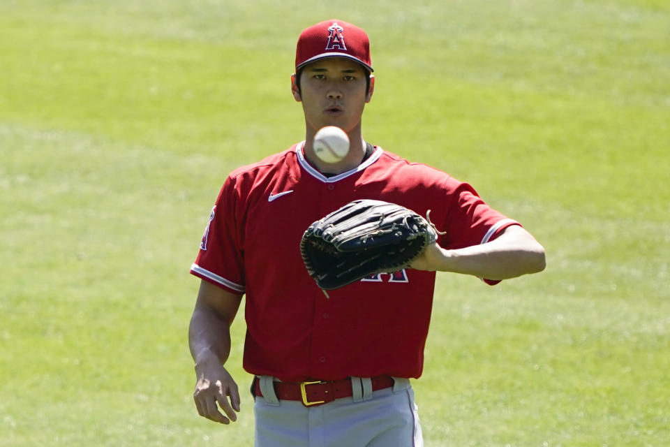 Los Angeles Angels designated hitter Shohei Ohtani (17) catches a ball during a baseball practice at Angels Stadium on Friday, July 3, 2020, in Anaheim, Calif. (AP Photo/Ashley Landis)