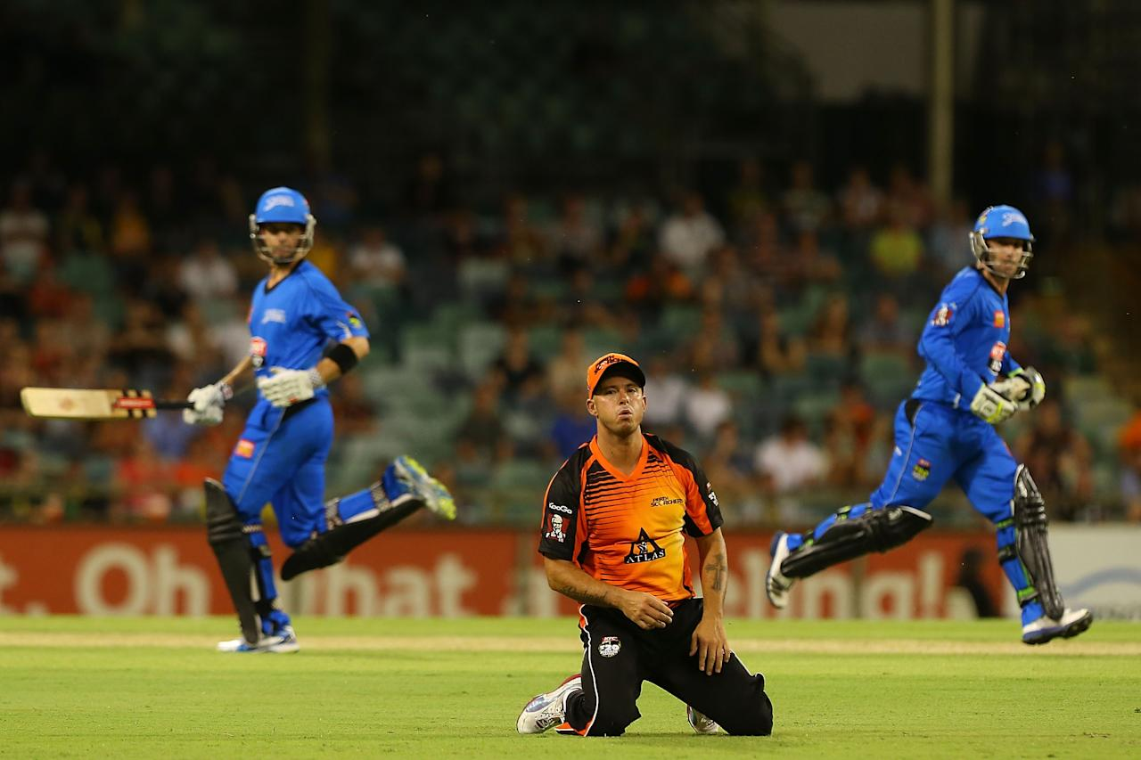 PERTH, AUSTRALIA - DECEMBER 09:  Herschelle Gibbs of the Scorchers watches the ball head to the boundary as Callum Ferguson and Phillip Hughes run during the Big Bash League match between the Perth Scorchers and Adelaide Strikers at WACA on December 9, 2012 in Perth, Australia.  (Photo by Paul Kane/Getty Images)