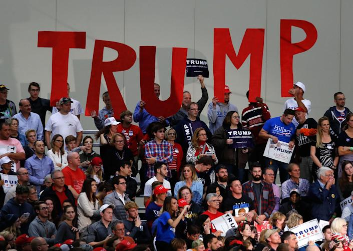 <p>Supporters hold signs for Republican presidential candidate Donald Trump campaign rally in Grand Rapids, Mich., Tuesday, Nov. 8, 2016. (Photo: Paul Sancya/AP) </p>