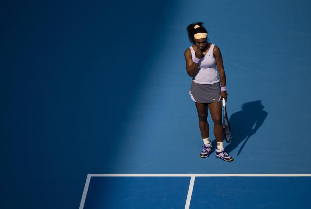 Serena Williams of U.S. bites her nail as she waits for a serve from Maria Kirilenko of Russia during the China Open tennis tournament at the National Tennis Stadium in Beijing, China Thursday, Oct. 3, 2013. (AP Photo/Andy Wong)