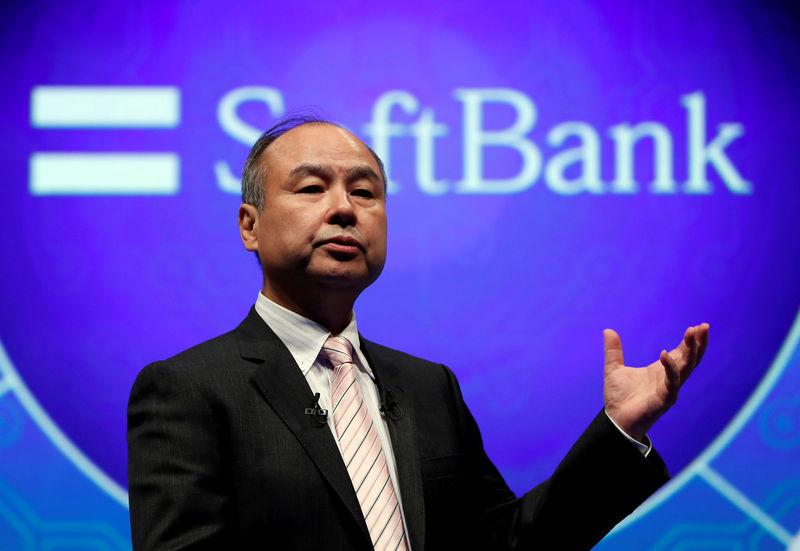 FILE PHOTO: SoftBank Group Corp Chairman and CEO Masayoshi Son speaks during their joint news conference with Toyota Motor Corp President Akio Toyoda in Tokyo