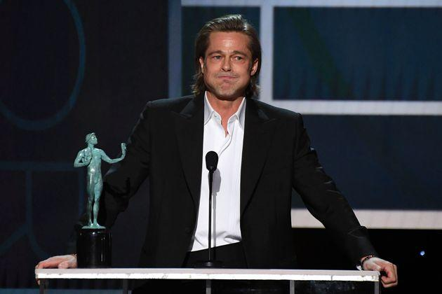 Brad Pitt accepts the award for Outstanding Performance by a Male Actor in a Supporting Role in a Motion Picture at the 26th Annual Screen Actors Guild Awards in Los Angeles on Sunday.