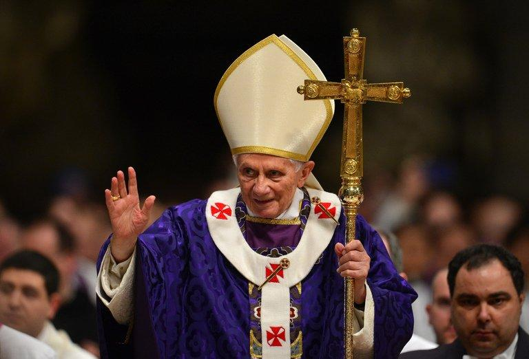 Pope Benedict XVI leaves after mass for Ash Wednesday on February 13, 2013 at St Peter's Basilica in the Vatican