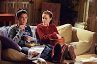 """<p>On behind-the-scenes footage, Melissa McCarthy (who played Sookie the chef) revealed that Lorelai and Rory's cushy-looking couch wasn't great for movie nights after all — it was """"<a href=""""http://hookedonhouses.net/2010/05/23/gilmore-girls-lorelais-house-the-gilmore-mansion/"""" rel=""""nofollow noopener"""" target=""""_blank"""" data-ylk=""""slk:like sitting on a pile of bricks"""" class=""""link rapid-noclick-resp"""">like sitting on a pile of bricks</a>.""""</p>"""