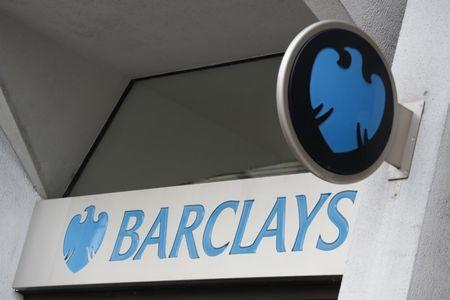 A Barclays sign is seen outside a branch of the bank in London