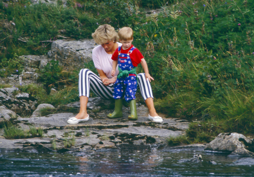 BALMORAL, SCOTLAND  -  AUGUST 18:   Diana, Princess of Wales, and Prince Harry play on the banks of the River Dee, near Balmoral Castle.during a Summer vacation, on August 18, 1987, in Balmoral, Scotland. (Photo by Julian Parker/UK Press via Getty Images)