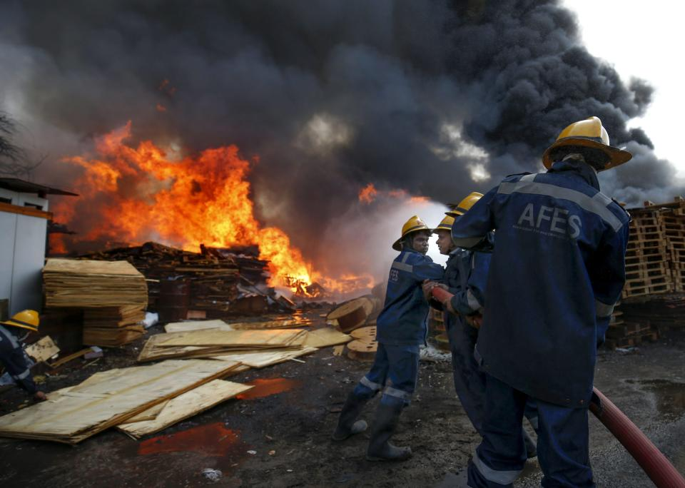 Firefighters attempt to douse a fire that broke out at a wood store in Ahmedabad.