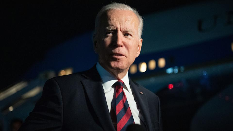 President Biden in front of an airplane
