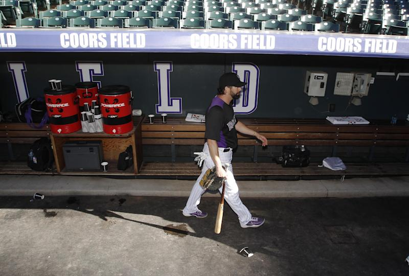 Colorado Rockies first baseman Todd Helton walks through the dugout after taking batting practice for the Rockies' baseball game against the Boston Red Sox in Denver on Wednesday, Sept. 25, 2013. Helton, who is retiring at season's end, was playing in his final home game on Wednesday night before concluding his career on the road in Los Angeles this weekend. (AP Photo/David Zalubowski)