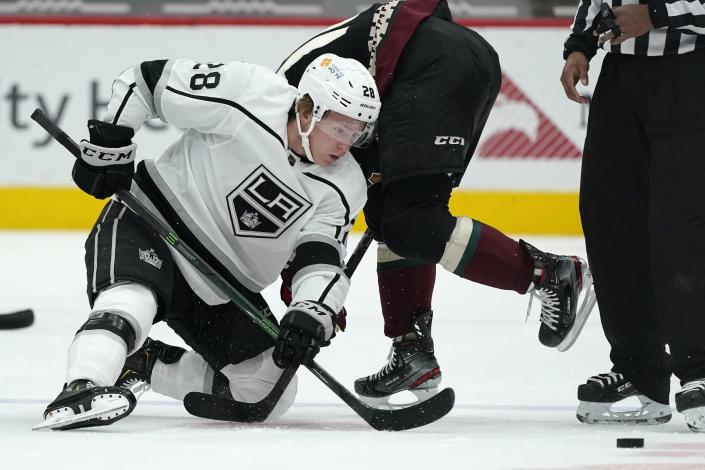 Los Angeles Kings center Jaret Anderson-Dolan (28) wins a face-off against Arizona Coyotes center Derick Brassard during the first period of an NHL hockey game Monday, May 3, 2021, in Glendale, Ariz. (AP Photo/Ross D. Franklin)