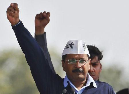 Kejriwal, chief of AAP shouts slogans after taking the oath as the new chief minister of Delhi during a swearing-in ceremony at Ramlila ground in New Delhi