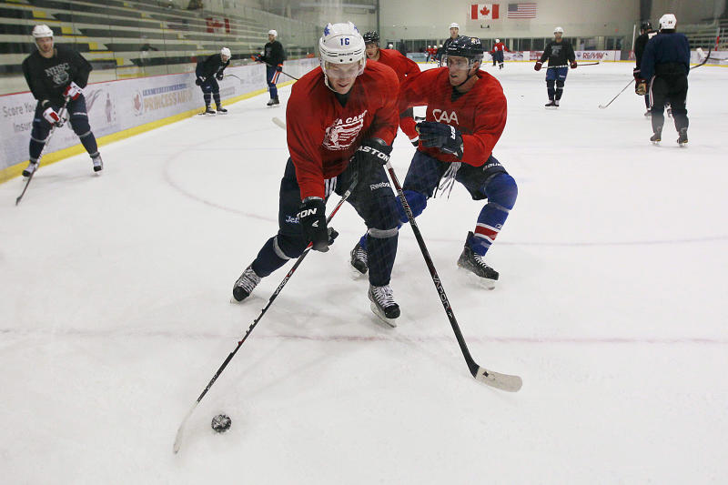 Winnipeg Jets' Bryan Little, left, handles the puck during an informal hockey practice in Winnipeg, Manitoba, on Wednesday, Sept. 19, 2012. The league locked out its players at last weekend, its fourth shutdown since 1992. (AP Photo/The Canadian Press, John Woods)