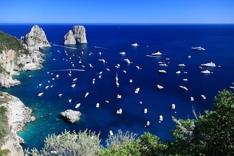 More than two million tourists visit Capri each year - Credit: getty
