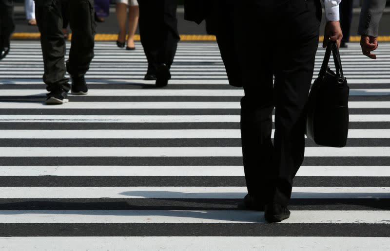 Japan services sector returns to growth in Jan. as sales tax hike impact fades