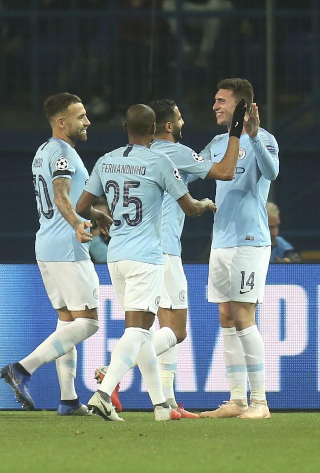 Manchester City Aymeric Laporte, right, celebrates with his teammates after scoring his side's second goal during the Group F Champions League soccer match between FC Shakhtar Donetsk and Manchester City at the Metalist Stadium in Kharkiv, Ukraine, Tuesday, Oct. 23, 2018. (AP Photo/Efrem Lukatsky)