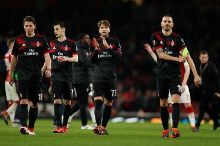 Soccer Football - Europa League Round of 16 Second Leg - Arsenal vs AC Milan - Emirates Stadium, London, Britain - March 15, 2018 AC Milan's Riccardo Montolivo, Nikola Kalinic, Manuel Locatelli and Leonardo Bonucci look dejected after the match Action Images via Reuters/John Sibley