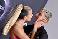 """<p>The loved-up duo <a href=""""https://www.popsugar.com/fashion/dua-lipa-pink-dress-at-amas-2019-46941510"""" class=""""link rapid-noclick-resp"""" rel=""""nofollow noopener"""" target=""""_blank"""" data-ylk=""""slk:walked the red carpet together"""">walked the red carpet together</a> at the 47th American Music Awards, marking their first red-carpet appearance as a couple. The PDA was everywhere in sight from smooches in front of the cameras to not being able to keep their hands off one another while on the carpet.</p>"""