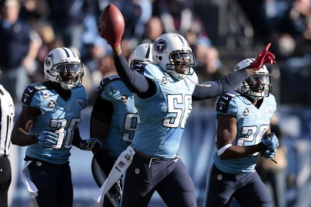 Tennessee Titans linebacker Akeem Ayers (56) celebrates after intercepting a pass against the Houston Texans in the third quarter of an NFL football game on Sunday, Dec. 29, 2013, in Nashville, Tenn. (AP Photo/Wade Payne)